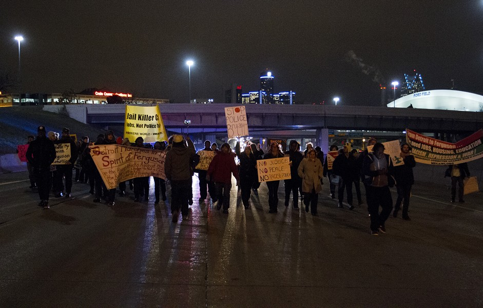 On Tuesday, Nov. 25, 2014, following the announcement that a grand jury would not indict the officer who shot 18-year-old Michael Brown, protesters in Detroit demonstrated across the city, including those seen here on I-75 just south of Mack Ave. - STEVE NEAVLING/MOTOR CITY MUCKRAKER