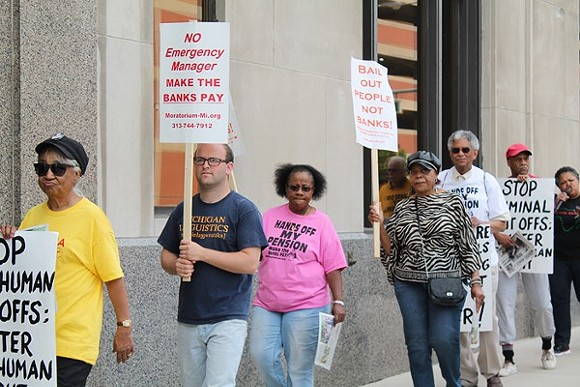 A coalition of activists protests outside the Detroit Water & Sewerage Department's office in downtown Detroit on Friday, June 6. - RYAN FELTON/METRO TIMES