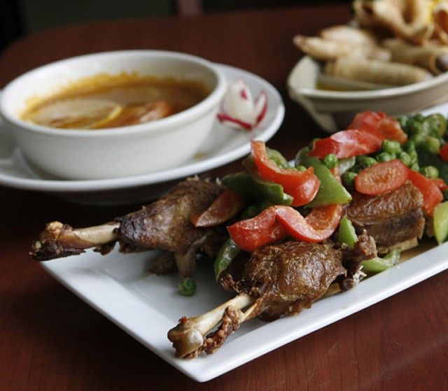 Pa-nang duck, tom yum gai soup, and assorted appetizers from Orchid Thai. - MT PHOTO: ROB WIDDIS