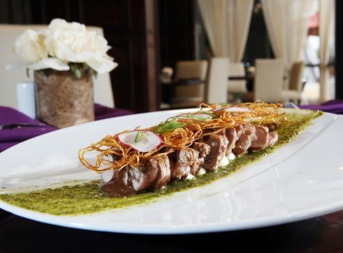 Pork tenderloin with five-herb pesto, goat cheese, chocolate wild mushrooms and potato cage, from Jefferson House in Detroit. - ROBERT WIDDIS