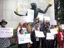 Protesters at the Coleman A. Young Municipal Building on Aug. 5 let EM Kevyn Orr know they were less than pleased with recent comments he made in the WSJ.