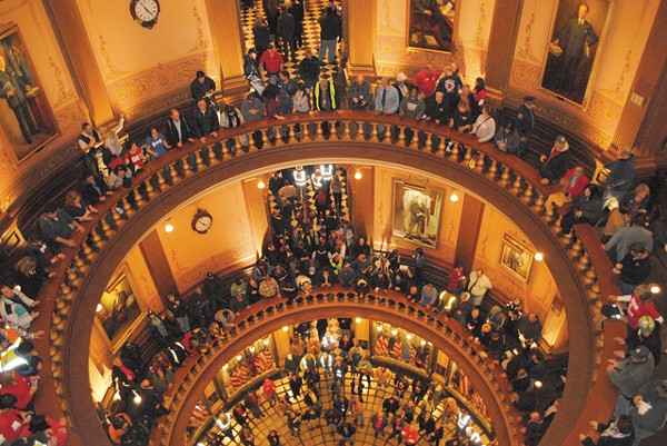 Protestors crowded into the Capitol rotunda Dec. 6. Demonstrators and Democratic legislative maneuvers have failed to blunt the GOP's moves - SAM INGLOT/CITY PULSE