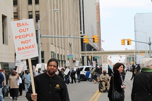 Retirees and supporters gathered outside of the Theodore Levin Federal Courthouse in downtown Detroit on Tuesday, April 1 to protest Detroit Emergency Manager Kevyn Orr's proposed bankruptcy-exit plan, which calls for cuts to monthly pension checks. - PHOTO BY RYAN FELTON.