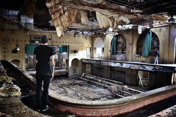 Seph Lawless examines a typical Detroit ruin. - PHOTO COURTESY OF SEPH LAWLESS.