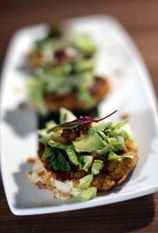 Spanish yapingacho: Potato cakes stuffed with queso blanco, avocado, peanut sauce and chorizo.