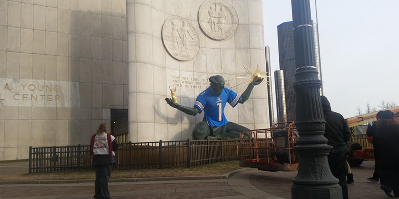 Spirit of Detroit, wearing a Lions jersey