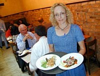 Streetside Seafood manager Tracy Goralski serves crab cakes and seared tuna appetizers. - METRO TIMES PHOTO / LARRY KAPLAN