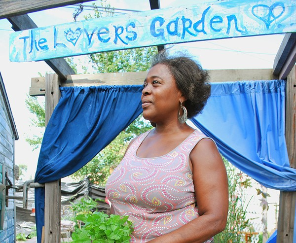 Tamra Meadows in her herb-filled garden