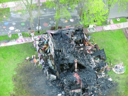 """The charred hulk of the """"Obstruction of Justice House"""" at Detroit's Heidelberg Project."""