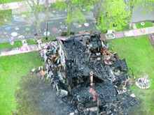 "The charred hulk of the ""Obstruction of Justice House"" at Detroit's Heidelberg Project."