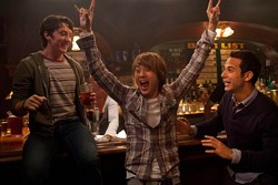 The drunk Asian dude gives 21 and Over four horns up!