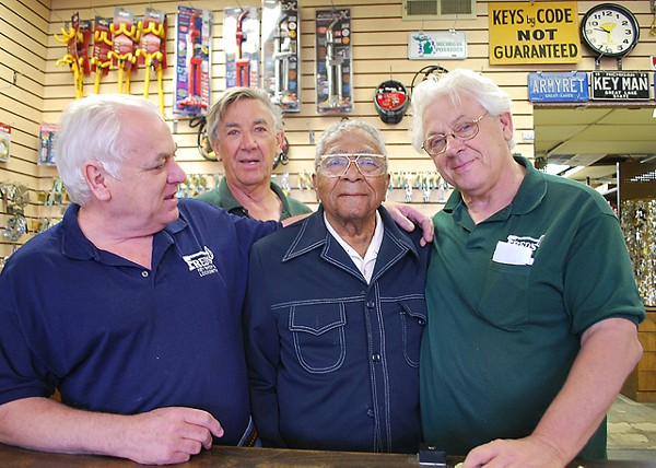 "The Knoche brothers with ""Fast Eddie"" Wyatt at Fred's Key Shop."