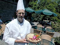 The Pool's executive chef, Peter Veach, serves planked whitefish with cherries and almonds. - METRO TIMES PHOTO / LARRY KAPLAN