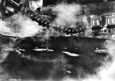 The western side of Ford Island on Dec. 7, 1941, during the attack. Farthest to the left is the USS Detroit, which was damaged that day. - U.S. NAVY (CAPTURED IMPERIAL JAPANESE NAVY PHOTO)