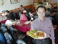 Thuy Trang: Owner Son Nguyen serves cha gio (crispy egg rolls). - METRO TIMES PHOTO / LARRY KAPLAN