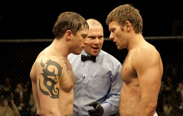 Tom Hardy (left) and Joel Edgerton hug it out in Warrior.