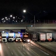Police coordinated 13 semi-trucks on I-696 to brace fall of suicidal man