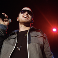 Mike Posner will play an acoustic show at Detroit's City Theatre as part of a walking cross-country tour