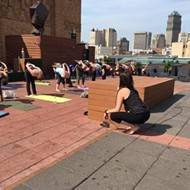 Raise money for Detroit Music Hall while doing yoga on its roof tonight