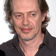 A guy named Kevin replaces family photos with Steve Buscemi's face