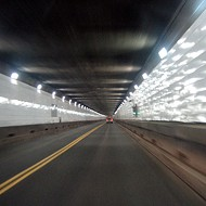 The Detroit-Windsor Tunnel is how old?