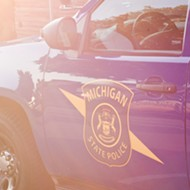 Black man attacked by K-9 for several minutes after surrendering sues Michigan State Police