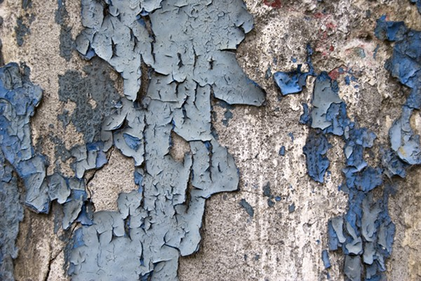 Paint peeling from an old home. - SHUTTERSTOCK