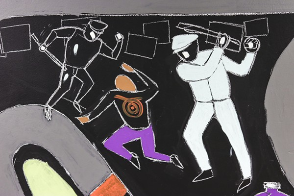 A person with a target on their back is shown being beaten by police in a mural by students at Detroit's Southeastern High School. - MARSHALL SKEETERS, HEIDELBERG PROJECT