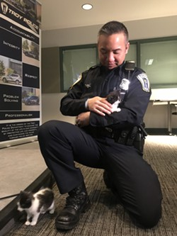 OFFICER JULIAN WITH A POTENTIAL CAT CANDIDATE.