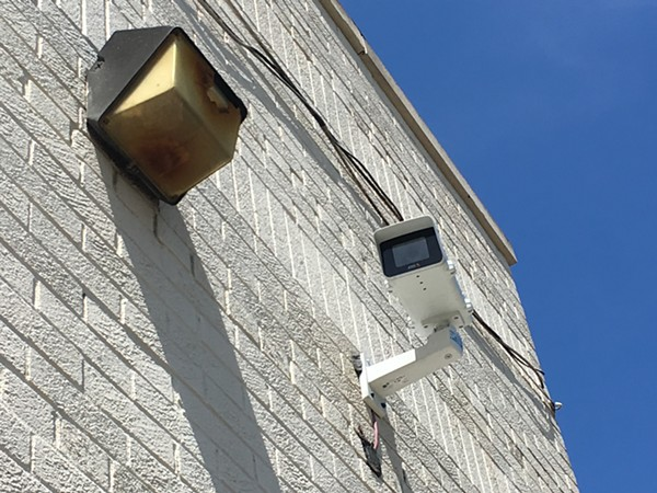 A Project Green Light camera at State Farm Insurance on 7 Mile and Livernois. The real-time crime monitoring program is drawing scrutiny as it expands to Detroit schools. - VIOLET IKONOMOVA