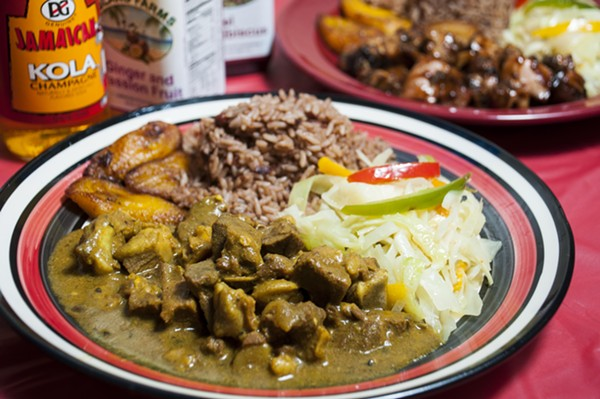 Curry goat at Jamaican Pot. - PHOTO BY TOM PERKINS