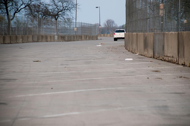 Concrete barricades and fencing on Belle Isle. - TOM PERKINS