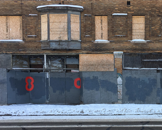 "Detroit artist Nick Jaskey's ""Red Circles"" dot Detroit's derelict buildings. - COURTESY PHOTO"
