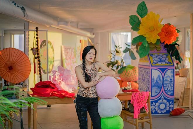 Louise Jones, aka Ouizi, puts the finishing touches on her installation for Movement Music Festival. - NOAH ELLIOTT MORRISON