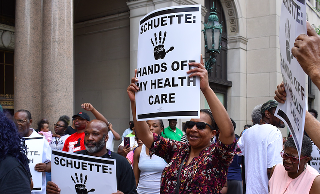 Protesters fight Medicaid work requirements outside the Detroit office gubernatorial candidate and Attorney General Bill Schuette in May. - COURTESY PHOTO