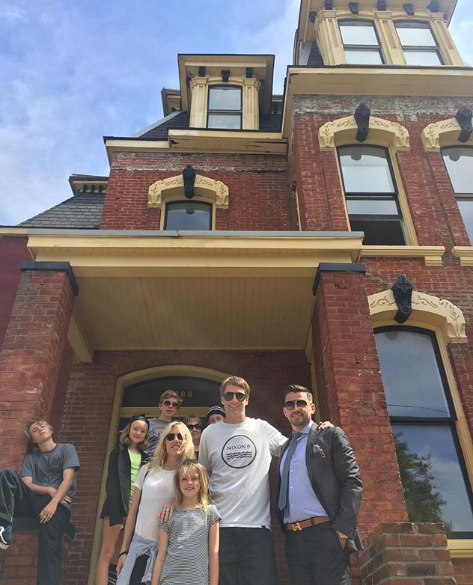 Hawk and his family pose in front of their Detroit home. - @JAMESTUMEY
