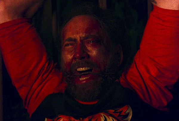 "Nic Cage looking all kinds of disturbed in ""Mandy"" - COURTESY PHOTO."
