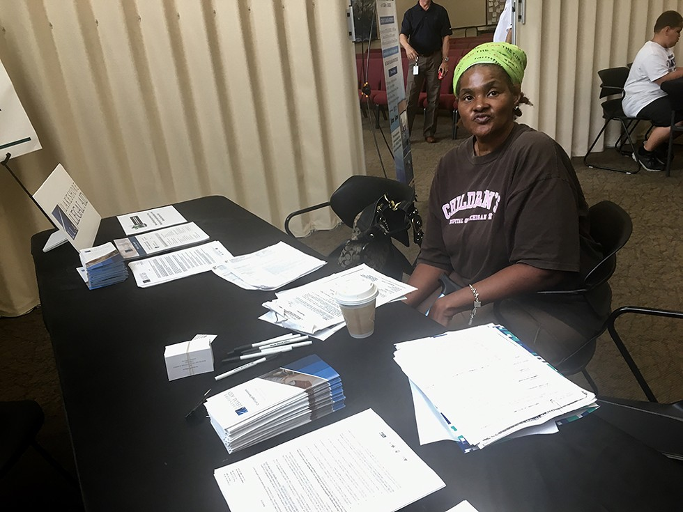 """A renter living under a """"ghost landlord"""" waits for legal help at an """"escrow fair"""" put on by the city of Detroit. - VIOLET IKONOMOVA"""