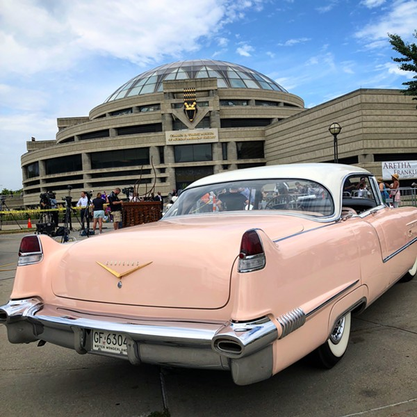 Mourners gather to Charles H. Wright Museum to pay their 'Respect' to the Queen of Soul. - DEVIN CULHAM