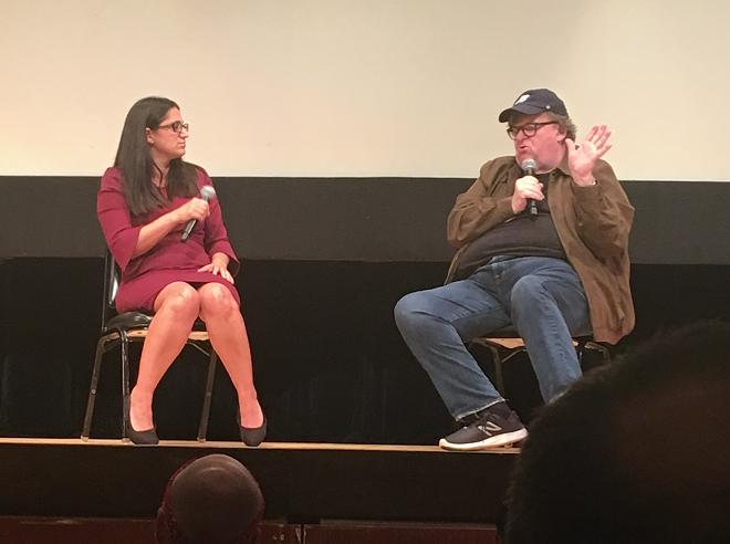 Dr. Mona Hanna-Attisha and Michael Moore speak at the premiere of Fahrenheit 11/9 in Flint. - COREY HALL
