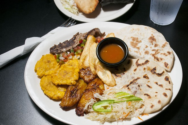 Pupusa, baleada, carne asada, tostones, platano maduro and tajadas at El Catracho. - TOM PERKINS