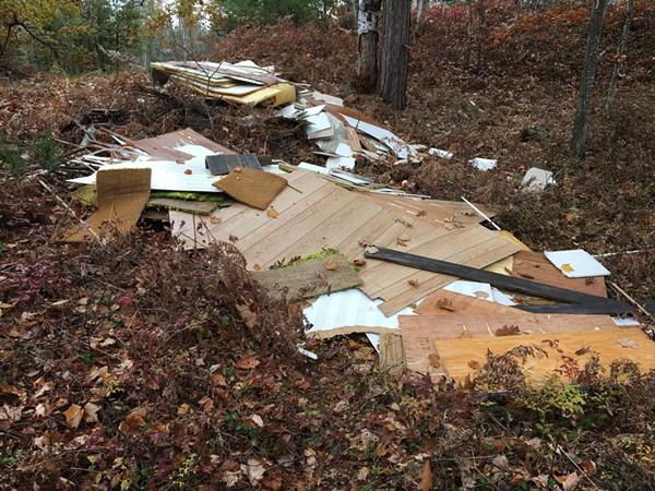 Sleeping Bear Dunes National Lakeshore rangers are seeking information on who dumped construction debris in the park - FACEBOOK: SLEEPING BEAR DUNES NATIONAL LAKESHORE