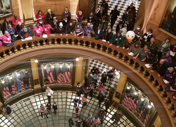 Protests at the Michigan State Capitol on Tuesday. - ELAISHIA OUTLEY