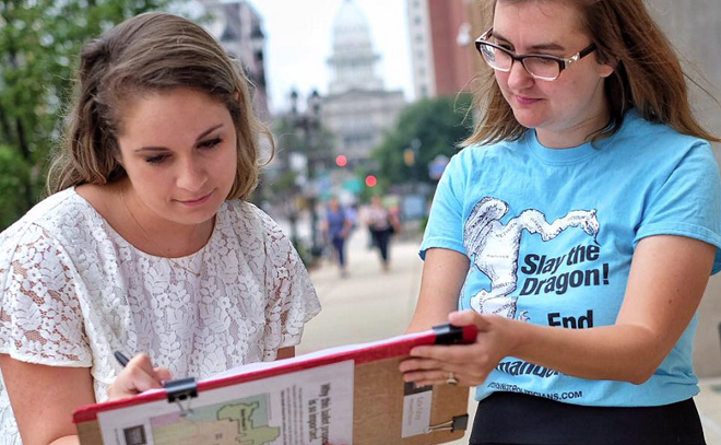 A volunteer for Voters Not Politicians collecting signatures to get the anti-gerrymandering proposal on the November ballot. The group collected more than 425,000 signatures. - COURTESY PHOTO