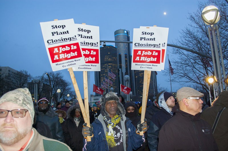 UAW workers hold a candlelight vigil after General Motors announces it will close five North American plants, including Detroit-Hamtramck Assembly. - LEE DEVITO