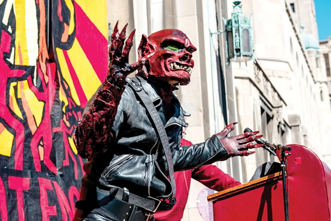"The ""Red Dwarf"" speaks at the Marche du Nain Rouge, 2015. - COURTESY OF MARCHE DU NAIN ROUGE"