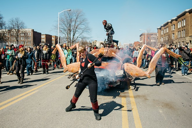 The Marche du Nain Rouge's cockroach chariot. - STEVEN PHAM