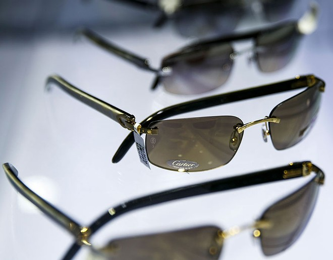Cartier sunglasses on display at Optica at Somerset Collection. - SEAN PROCTOR