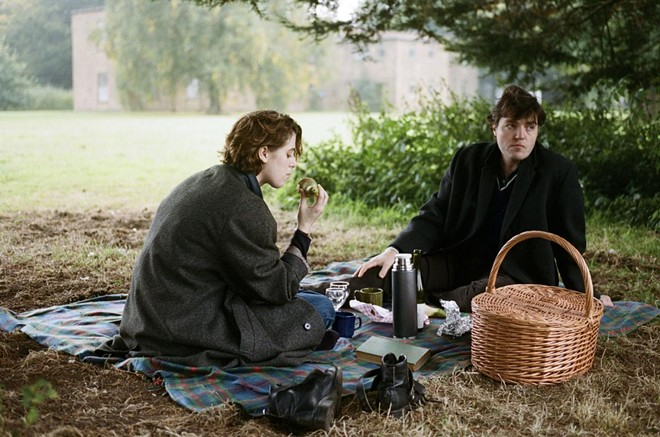 Honor Swinton Byrne as Julie and Tom Burke as Anthony in The Souvenir. - COURTESY OF A24
