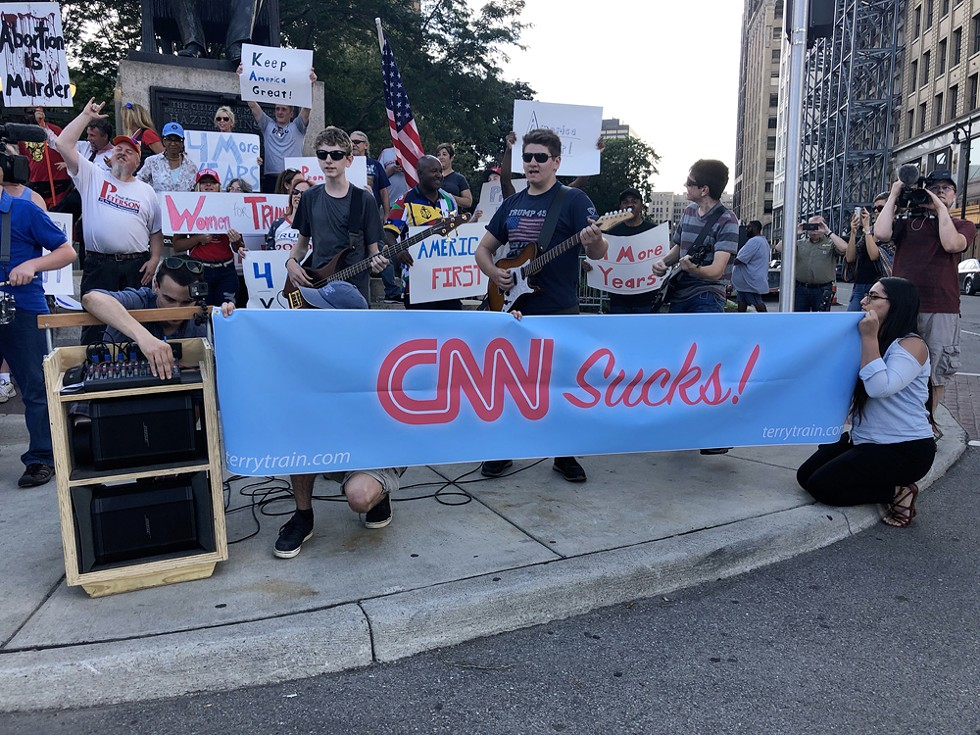 Trump supporters outside of the CNN Democratic debates in Detroit. They have a point. - STEVE NEAVLING